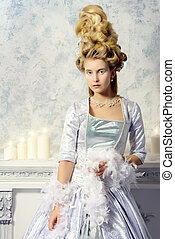 snow palace - Elegant young woman in a lush white medieval...