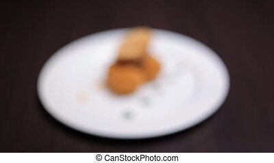 Chicken nuggets and chips - There is a beautiful white plate...