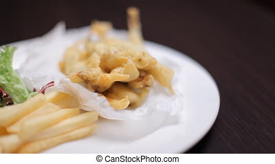 Deep-fried fish with vegetables - There is a beautiful white...