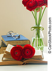 Old books with red flower - Pile of old books with red...