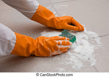 housework - hand washing floor by cleaning sponge with foam