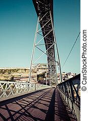 Street on lower floor of the Ponte Luiz I Bridge in Porto, Portugal.