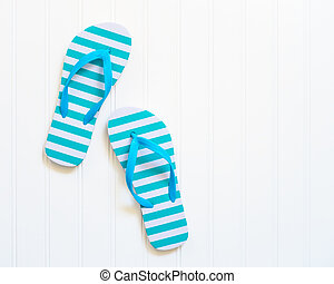 Beach Flip Flops - Blue and white beach sandals commonly...