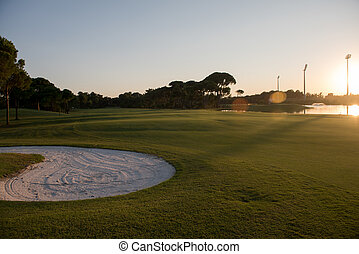 golf course on sunset - golf course landscape at beautiful...