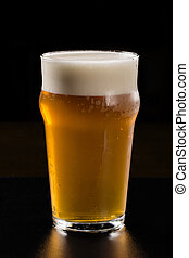 beer on the black background