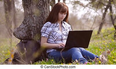 Woman resting sitting at a computer - Beautiful woman has a...