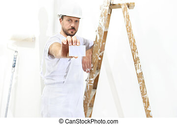 painter man hand with business card, ladder on white wall background,