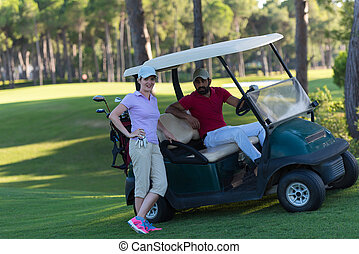 couple in buggy on golf course - couple in buggy cart on...
