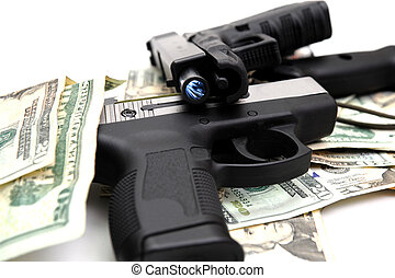 Handguns And Cash - Two semi automatic handguns on a pile of...