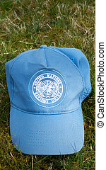 United Nations Hat - A blue United Nations Cap lying in...