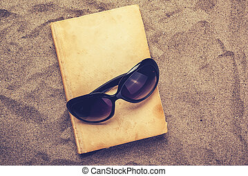 Reading favourite old book on summer vacation beach holiday