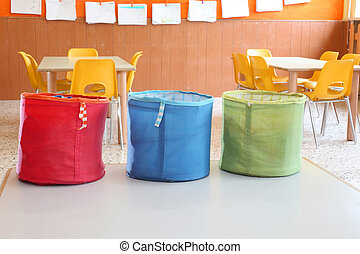 three colored jars for games in kindergarten class - three...