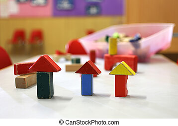 wooden toys and pieces of buildings in the nursery class -...