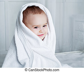 baby with a towel - one year old baby in bed with a towel...