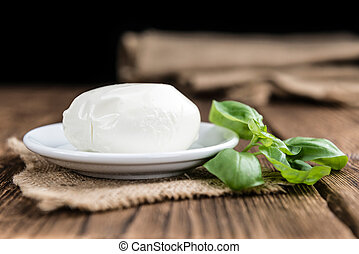 Mozzarella - Portion of fresh Mozzarella close-up shot on...
