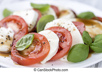 Mozzarella, Tomatoes and Balasmico Dressing (close-up shot;...