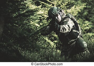 Special Forces Soldier. Camouflaged Marine Soldier Shooting...