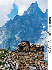 Vintage Italian Alp Architecture Rocky Roof and Chimneys...