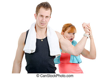 woman examining flexing biceps of her muscular boyfriend