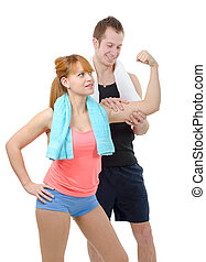 young man looks at biceps of his girlfriend, on white...