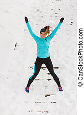 Woman exercising in the snow - Woman fit fitness girl...
