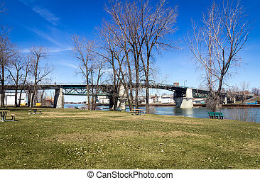 Sorel-Tracy Quebec Canada old bridge park landscape at...