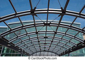 Entrance to a modern steel and glass building - a glass and...