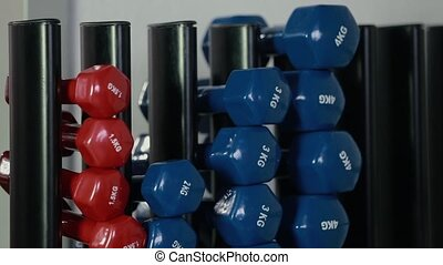 Close-up of a girl picks up a dumbbell HD