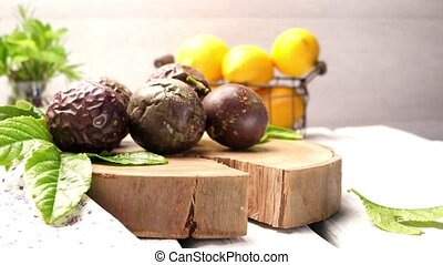 Passion fruits on wooden tray on wooden table background.