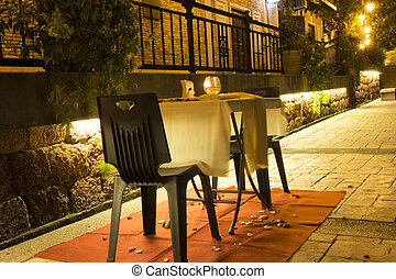 Table and seats in romantic atmosphere - Table and seats for...