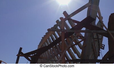 Ship skeleton against the sun - Wooden ship construction or...