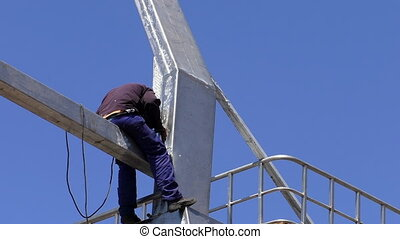 Welder working metal construction - Man welding a metal...
