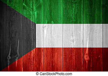 flag of Kuwait or Kuwaiti banner on wooden background