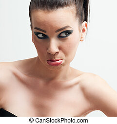 Grimacing - Young adult woman pouting