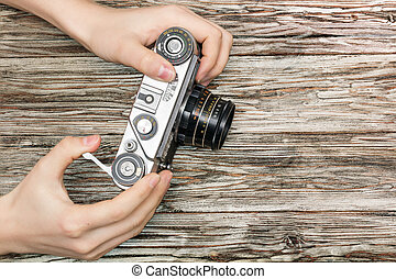 woman and 39;s hands holding a retro camera - woman39;s...