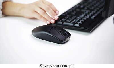woman hands typing on computer keyboard at office -...