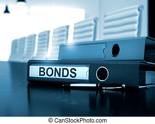 Bonds on Binder Blurred Image - Bonds - Business Concept on...