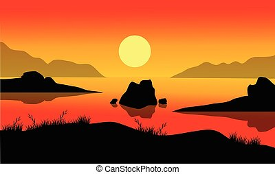 Landscape of rock in sea at the sunrise