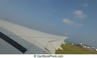 wing of airplane taking off - travel, transportation,...