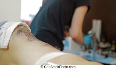Tattoo artist make tattoo at studio
