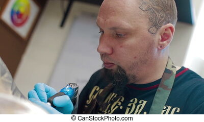 Tattoo artist make tattoo at studio - Tattoo artist make...