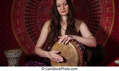Woman playing drum indoors - Adult woman playing drum...