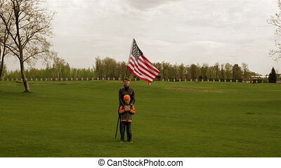 Mother and son are about the US flag - Young woman and baby...