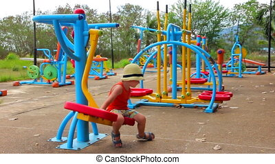 Little Boy on the Playground - Little boy is playing on...