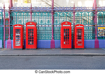Red Phone Booths - Traditional British red phone booths in a...