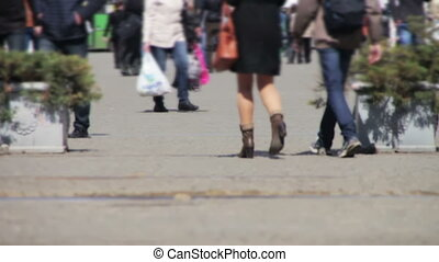 Anonymous People Walking on the Street. Defocused. Crowd...
