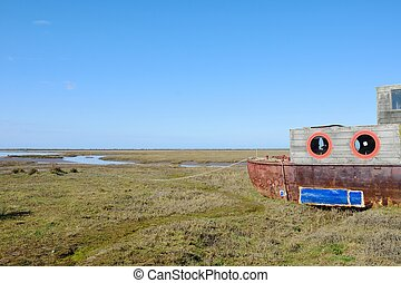 Wooden Houseboat in estuary norfolk