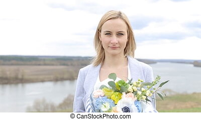 Beautiful young lady offer colored flower bouquet