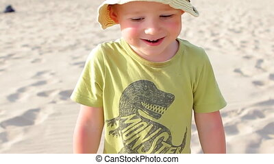 Smiling Boy Walking on the Beach