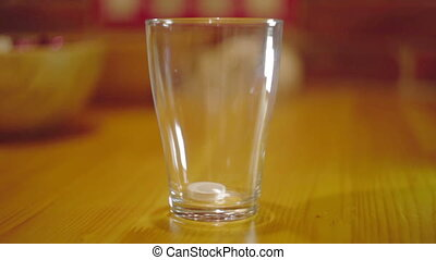 Tablet Dissolving in Glass Water - Tablet Dissolving in the...